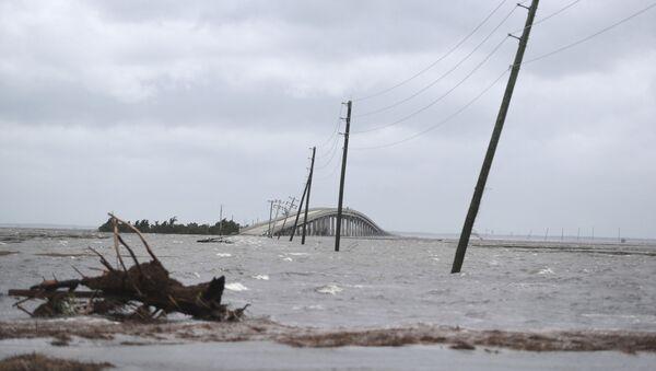 Storm surge from Hurricane Dorian blocks Cedar Island off from the mainland on NC 12 in Atlantic Beach, N.C., after Hurricane Dorian past the coast on Friday, Sept. 6, 2019. (AP Photo/Tom Copeland) - Sputnik International