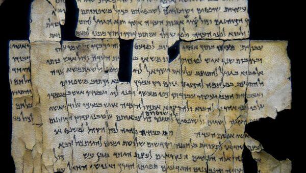 Part of Dead Sea Scroll number 28a (1Q28a) from Qumran Cave 1. From Qumran (Khirbet Qumran or Wadi Qumran), West Bank of the Jordan River, near the Dead Sea, modern-day State of Israel. The Jordan Museum, Amman, Jordan Hashimite Kingdom. - Sputnik International