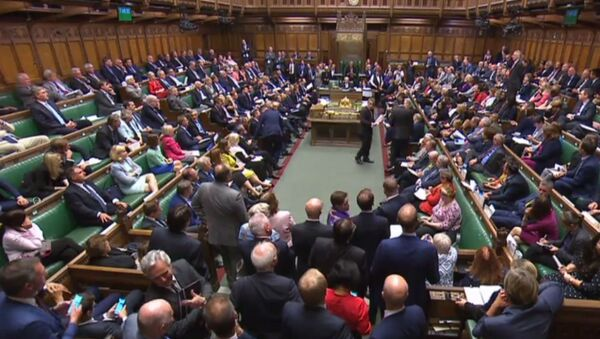 A video grab from footage broadcast by the UK Parliament's Parliamentary Recording Unit (PRU) shows MPs filing back into the House after voting on the third reading of the European Union Withdrawal No 6 Bill, a bill to delay Brexit for three months, in the House of Commons in London on September 4, 2019 - Sputnik International