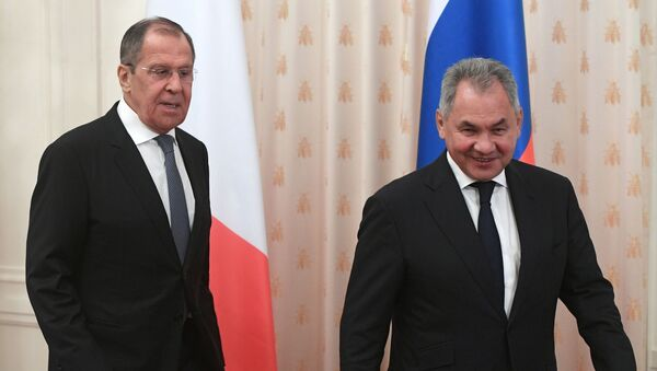Russian Foreign Minister Sergei Lavrov and Defence Minister Sergei Shoigu - Sputnik International