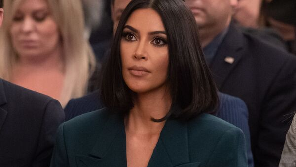 Kim Kardashian listens as US President Donald Trump speaks about  second chance hiring and criminal justice reform in the East Room of the White House in Washington, DC, June 13, 2019.  - Sputnik International