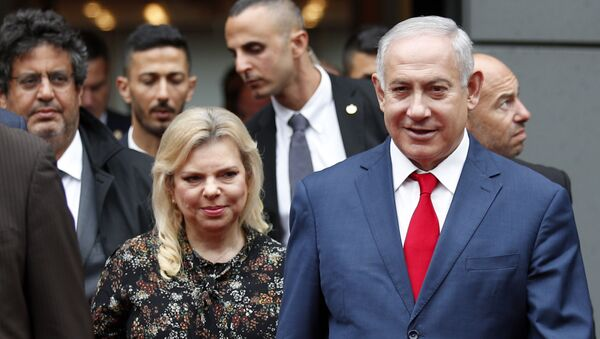 Israel's Prime Minister Benjamin Netanyahu and his wife Sara Netanyahu walk out after their meeting with French Finance Minister Bruno Le Maire, second left, at Bercy Economy Ministry, in Paris, Wednesday, June 6, 2018. - Sputnik International