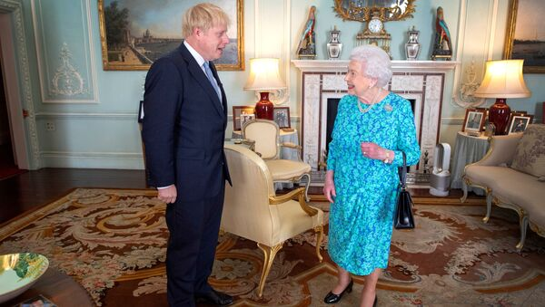 FILE PHOTO: Queen Elizabeth II welcomes Boris Johnson during an audience in Buckingham Palace, where she will officially recognise him as the new Prime Minister, in London, Britain July 24, 2019. - Sputnik International