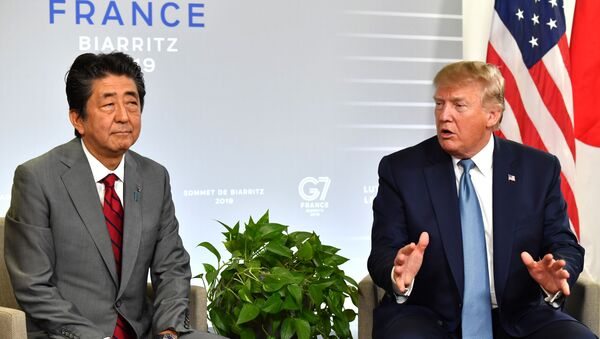 Japan's Prime Minister Shinzo Abe (L) listens to US President Donald Trump during a bilateral meeting on the sidelines of the G7 summit in Biarritz, south-west France on August 25, 2019, - Sputnik International