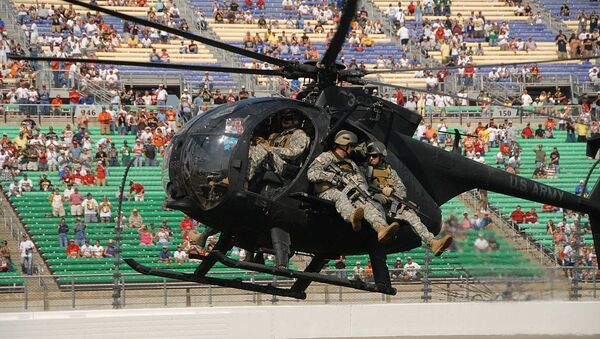 An MH-6 Little Bird from 160th SOAR carrying Special Forces Soldiers from the 5th SFG(A) prepares to land during a SOF aeriel infiltration demonstration Sept. 28 at NASCAR's Kansas Speedway 400. (Photo by Spc. Tony Hawkins, USASOC PAO) - Sputnik International