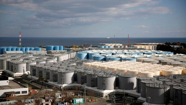 FILE PHOTO: Storage tanks for radioactive water are seen at Tokyo Electric Power Co's (TEPCO) tsunami-crippled Fukushima Daiichi nuclear power plant in Okuma town, Fukushima prefecture, Japan February 18, 2019 - Sputnik International