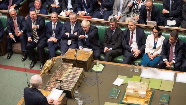 Britain's Prime Minister Boris Johnson gestures as leader of the opposition Labour Party Jeremy Corbyn (bottom) speaks in the House of Commons in London, Britain September 3, 2019 - Sputnik International