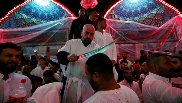 Shi'ite Muslims men flagellate themselves during a ceremony marking Ashura in the holy city of Kerbala, Iraq, September 10, 2019 - Sputnik International