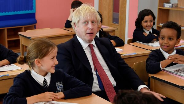 Britain's Prime Minister Boris Johnson attends a class during his visit to Pimlico Primary school in London on September 10, 2019 - Sputnik International