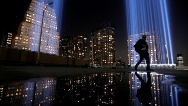 A man walks by the Tribute in Light, lit to commemorate the 18th anniversary of September 11, 2001 attacks in New York City, U.S., September 10, 2019 - Sputnik International