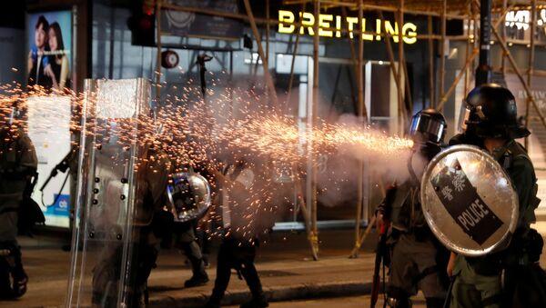 Riot police fire tear gas near Causeway Bay station in Hong Kong, China September 8, 2019 - Sputnik International