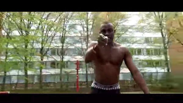 Screenshot from JCBUZ's music video I'm the S*** - Sputnik International