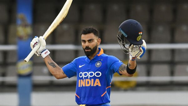 India's Virat Kohli celebrates his century during the third one-day international match between the West Indies and India at Queens Park Oval, Port of Spain, Trinidad and Tobago, on 14 August 2019. - Sputnik International