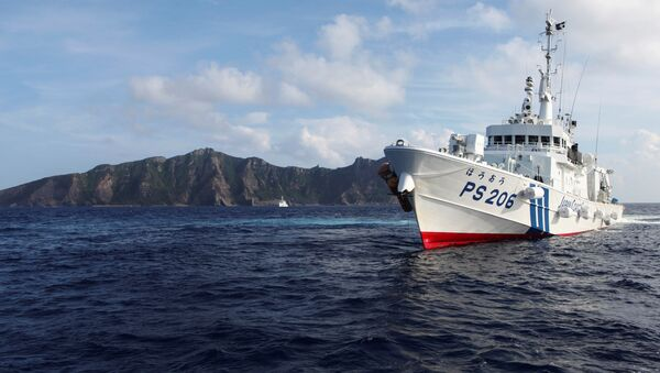 Japan Coast Guard vessel PS206 Houou sails in front of Uotsuri island, one of the disputed islands, called Senkaku in Japan and Diaoyu in China, in the East China Sea August 18, 2013.  REUTERS/Ruairidh Villar/File Photo - Sputnik International