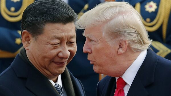 FILE - In this Nov. 9, 2017, file photo, U.S. President Donald Trump, right, chats with Chinese President Xi Jinping during a welcome ceremony at the Great Hall of the People in Beijing - Sputnik International