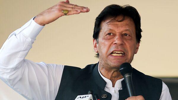 Pakistan's Prime Minister Imran Khan speaks during a rally in Muzaffarabad on September 13, 2019 - Sputnik International