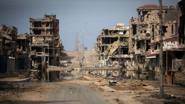 This Oct. 22, 2011 file photo, shows a general view of buildings ravaged by fighting in Sirte, Libya. - Sputnik International