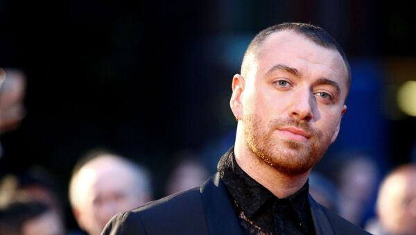 FILE PHOTO: Singer Sam Smith poses as they arrive to the GQ Men Of The Year Awards 2019 in London, 3 September 2019. REUTERS/Henry Nicholls - Sputnik International