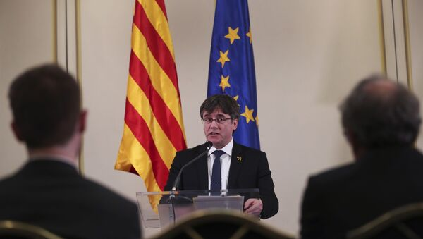 In this Feb. 18, 2019 file photo, Catalonia's former regional president. Carles Puigdemont, addresses a conference in Brussels. A political group that wants Catalonia to break away from Spain and become an independent country said on Sunday, March 10, 2019, that Puigdemont is running for a seat in the European Parliament even though the Spanish government considers him a fugitive. (AP Photo/Francisco Seco, File) - Sputnik International