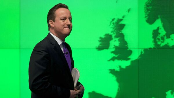 FILE - In this Wednesday, Jan. 23, 2013 file photo Britain's Prime Minister David Cameron walks past a map of Europe on a screen as he walks away after making a speech on holding a referendum on staying in the European Union in London. - Sputnik International