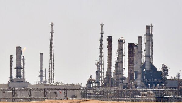 A picture taken on September 15, 2019 shows an Aramco oil facility near al-Khurj area, just south of the Saudi capital Riyadh.  - Sputnik International