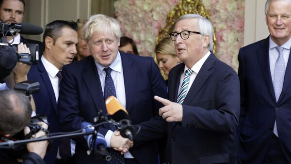 European Commission President Jean-Claude Juncker, center right, speaks with the media as he shakes hands with British Prime Minister Boris Johnson prior to a meeting at a restaurant in Luxembourg, Monday, Sept. 16, 2019 - Sputnik International
