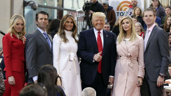 Republican presidential candidate Donald Trump, fourth from left, poses for a photo with family members on the NBC Today television program, in New York, Thursday, April 21, 2016. From left are: daughter Tiffany Trump, son Donald Trump Jr., his wife Melania Trump, daughter Ivanka Trump, and son Eric Trump. (AP Photo/Richard Drew) - Sputnik International