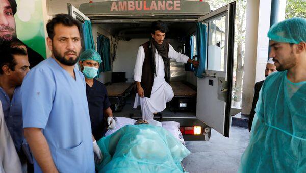 An injured man is transported to an ambulance at a hospital, after a blast in Kabul, Afghanistan September 17, 2019 - Sputnik International