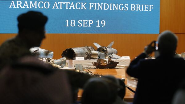 Journalists film what Saudi military spokesman Col. Turki al-Malki said was evidence of Iranian weaponry used in the attack targeted Saudi Aramco's facilities in Abqaiq and Khurais, during a press conference in Riyadh, Saudi Arabia, Wednesday, Sept. 18, 2019 - Sputnik International
