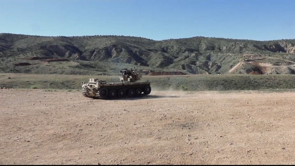 During a recent test, the team of Pratt & Miller, Northrop Grumman and EOS, showed the capability of the Pratt & Miller expeditionary modular autonomous vehicle, or EMAV to fire the M230 Link Fed (M230LF) integrated on the vehicle with the EOS R400 Remote Weapons station. - Sputnik International