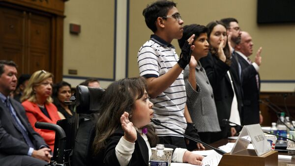 Witnesses including from left, Maria Isabel Bueso of Concord, Calif., Jonathan Sanchez, 16, of Boston, Penn State Law School Center for Immigrants' Rights Clinic Director Shoba Sivaprasad Wadhia, Fiona Danaher, a Harvard Medical School Instructor in Pediatrics, Anthony Marino, Irish International Immigrant Center Director of Immigration Legal Services, and Thomas Homan, former Acting Director of the U.S. Immigration and Customs Enforcement, are sworn in at a House Oversight subcommittee hearing into the Trump administration's decision to stop considering requests from immigrants seeking to remain in the country for medical treatment and other hardships, Wednesday, Sept. 11, 2019 - Sputnik International