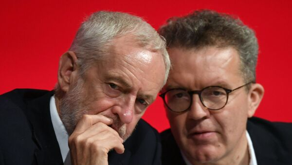 Britain's opposition Labour Party leader Jeremy Corbyn, left, talks with deputy leader Tom Watson during the start of the party's annual conference in Liverpool, England - Sputnik International