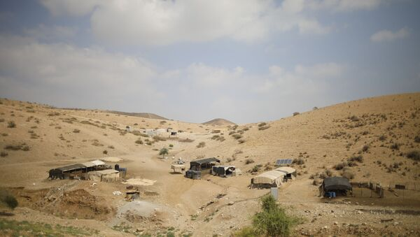 Palestinian Bedouin homes are seen in the Israeli-occupied West Bank, Wednesday, Sept. 11, 2019. Israeli Prime Minister Benjamin Netanyahu's election eve vow to annex the Jordan Valley if he is re-elected has sparked an angry Arab rebuke and injected the Palestinians into a campaign that had almost entirely ignored them. (AP Photo/Ariel Schalit) - Sputnik International