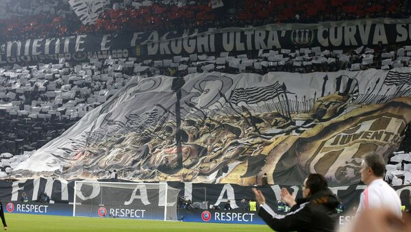 Juventus fans unveil a giant banner prior to the Champions League, round of 16, first-leg soccer match between Juventus and Bayern Munich at the Juventus stadium in Turin, Italy.  - Sputnik International