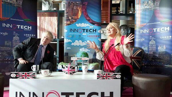 Boris Johnson, then-Mayor of London, speaks with Jennifer Arcuri at an event organised by her company, Innotech, in London on 30 October 2013. - Sputnik International
