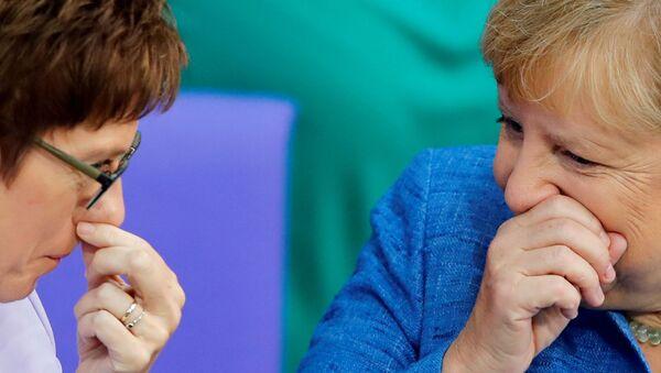 German Chancellor Angela Merkel talks with German Defence Minister Annegret Kramp-Karrenbauer during the budget debate in the Bundestag, the lower house of parliament in Berlin, Germany September 11, 2019. - Sputnik International