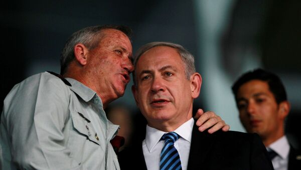 Israel's Prime Minister Benjamin Netanyahu (R) and Israel's armed forces chief Major-General Benny Gantz speak during the opening ceremony of the 19th Maccabiah Games at Teddy Stadium in Jerusalem July 18, 2013 - Sputnik International