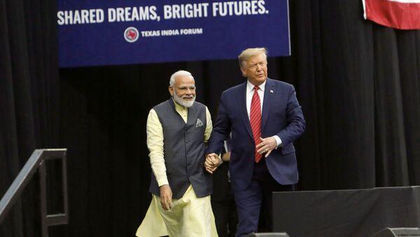 U.S. President Donald Trump and Indian Prime Minister Narendra Modi during a Howdy, Modi rally celebrating Modi at NRG Stadium in Houston, Texas, U.S. September 22, 2019 - Sputnik International