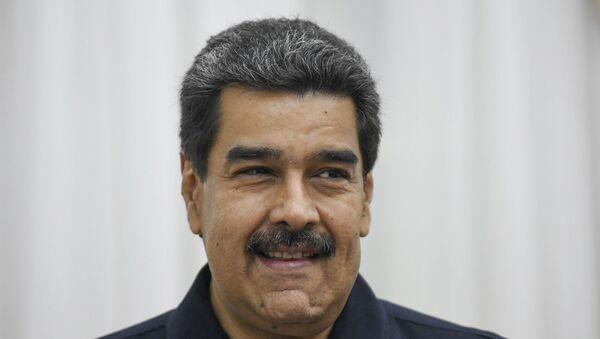 Venezuela's President Nicolas Maduro waits for Enrique Iglesias, a Special Adviser of the European Union for Venezuela, before their meeting at the Miraflores Palace in Caracas, Venezuela. - Sputnik International