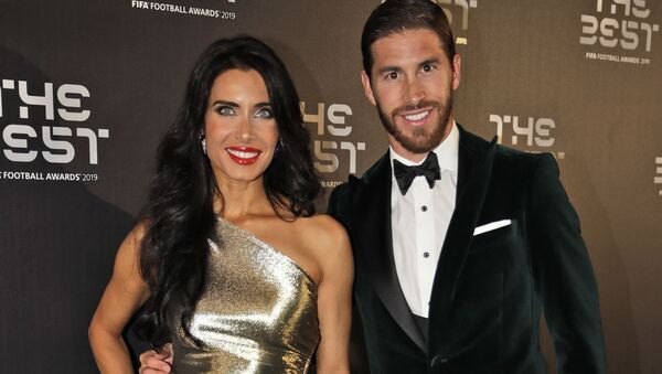 Real Madrid's Sergio Ramos arrives with his partner Pilar Rubio - Sputnik International