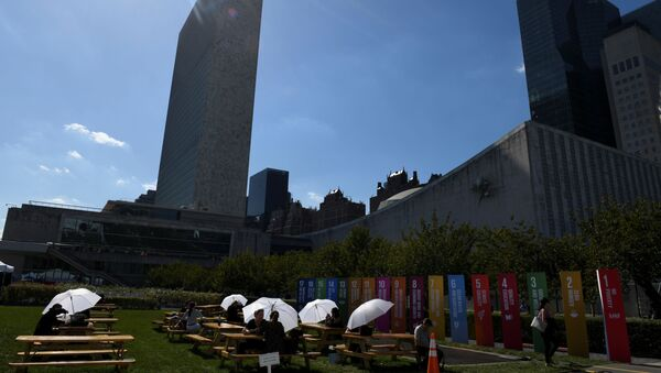 Attendees of the United Nations General Assembly use white umbrellas for shade at the United Nations in New York City, New York, U.S., September 25, 2019 - Sputnik International