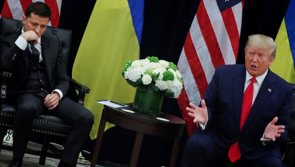 Ukraine's President Volodymyr Zelenskiy listens to U.S. President Donald Trump address reporters during a bilateral meeting on the sidelines of the 74th session of the United Nations General Assembly (UNGA) in New York City - Sputnik International