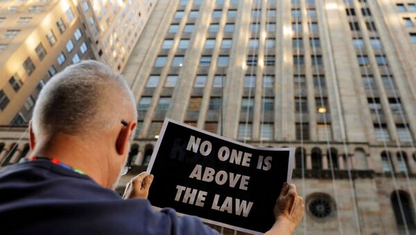 Demonstrators hold protest signs as part of a demonstration in support of impeachment hearings in New York, U.S., September 26, 2019.  - Sputnik International
