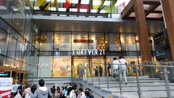 Forever 21. the California-based, private and family-held retailer that helped earlier popularize fast fashion in the United States said that it would file for bankruptcy, ceasing operations in 40 countries, including Canada and Japan, as part of a Chapter 11 filing - Sputnik International