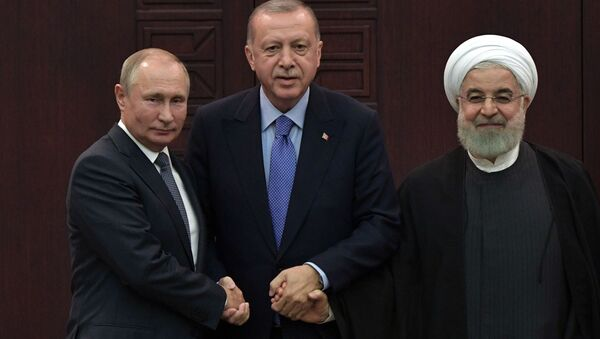 President of Russia Vladimir Putin, Turkish President Recep Tayyip Erdogan and Iranian President Hassan Rouhani during a joint press conference after the 5th Trilateral Summit in Astana format on the Syrian crisis   - Sputnik International