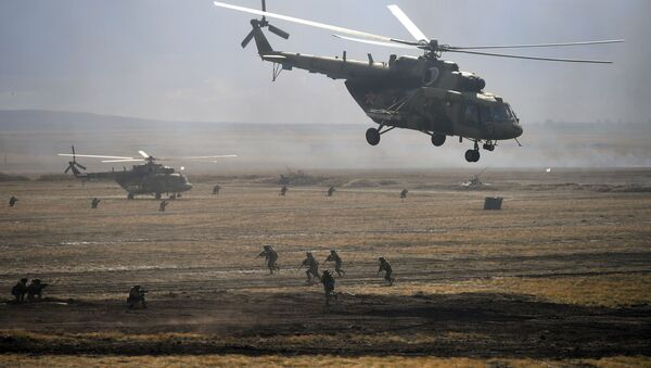 Mi-8 helicopters during the main stage of the Centre - 2019 strategic exercises at the Donguz training ground - Sputnik International