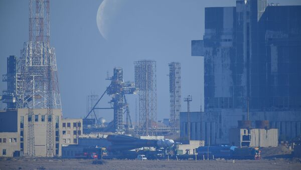 Russia's Soyuz-FG rocket booster carrying the Soyuz MS-15 spacecraft is transported from an assembling hangar to the launchpad ahead of its upcoming launch, at the Baikonur Cosmodrome, in Kazakhstan. - Sputnik International