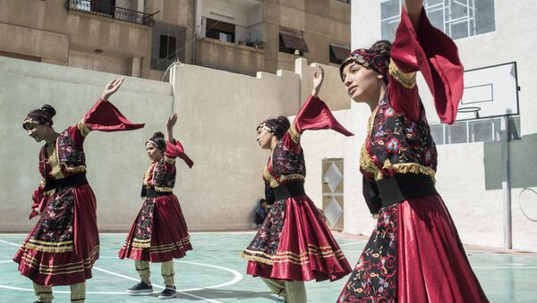 Girls in national costumes perform during the opening of a school in Barzeh district in Damascus - Sputnik International