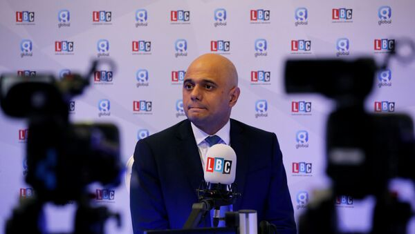 Britain's Chancellor of the Exchequer Sajid Javid participates in a radio interview during the Conservative Party annual conference in Manchester, Britain, September 30, 2019 - Sputnik International