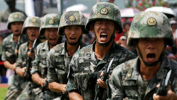 People's Liberation Army (PLA) soldiers take part in a performance during an open day at Stonecutters Island naval base in Hong Kong - Sputnik International
